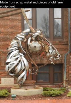 Made from scrap metal and pieces of old farm equipment