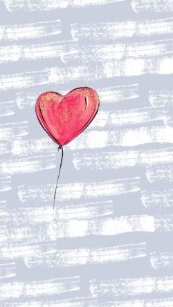 flying heart-shaped balloon